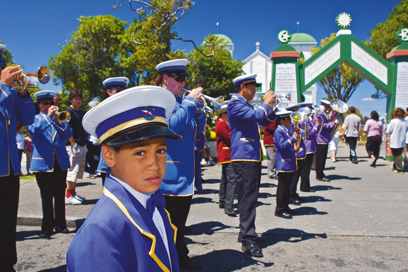 A brass band, always a regular feature at Ratana events, forms a guard of honour as church members enter the temple gates for a service. Generations of families visit Ratana Pa every year, many because a family member was touched by Ratana's ministry decades earlier.
