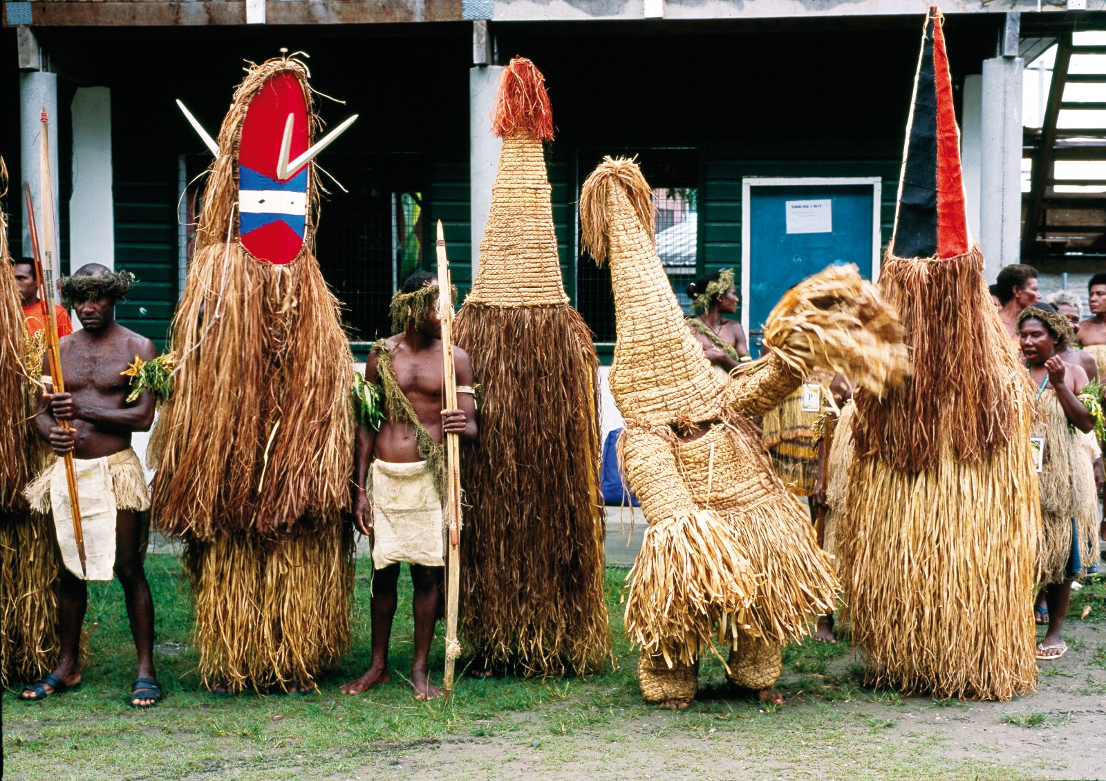 The figures of masked and disguised spirit creatures are found throughout Melanesia, echoing religious practices in which ancestors are believed to visit from the spirit world with messages and affirmations to the living. Few are as iconic as Temotu Province's tamate costume of pigmented and shredded fibre, traditionally burned after performances.