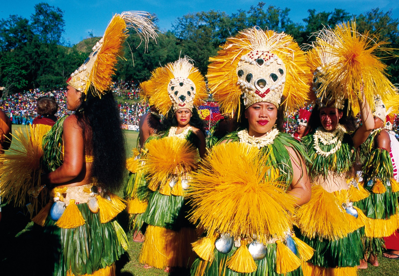 Women's 'ote'a dance from Tahiti and the Society Islands of French Polynesia features distinctive hip movements, ranging from isolated side thrusts through to shimmering circles or figures of eight. Spectacular costumes are made from brightly dyed, shredded pandanus and include high headdresses adorned with pearl shell.