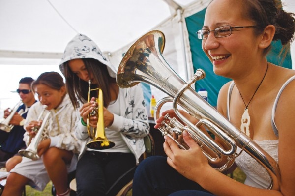 Kimberley Abraham and members of the band Te Reo o te Mangai have a practice during Ratana celebrations, 2008.