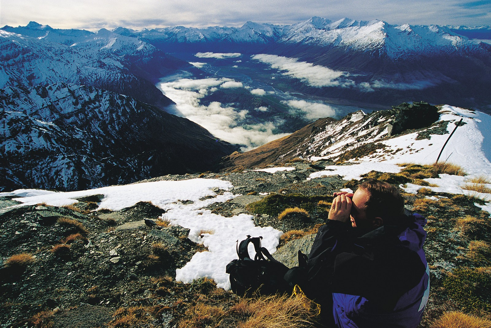 Like a hunter scoping for game, the author looks for routes in the mountains above the Matukituki Valley, near Treble Cone skifield.