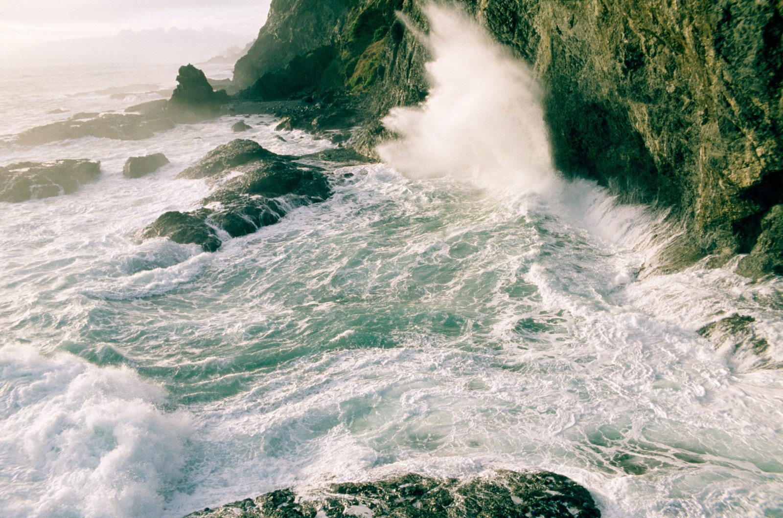 Wild water hammers the cliffs at Cape Reinga.