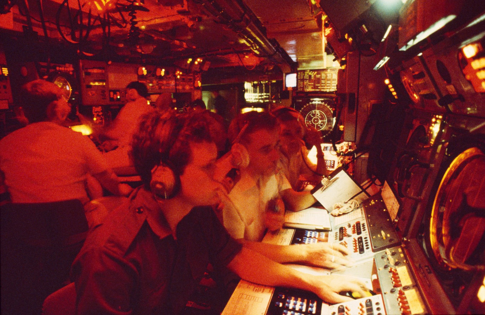 "The operations room collates ""action information"" gathered by radar, sonar and electronic warfare equipment so that the ship's command can make instant tactical decisions. When the Southland is in an ""action state"" these electronic eyes and ears provide a picture of what is happening over the horizon, and the captain directs battle from a computer screen in semi-darkness in this nerve centre."