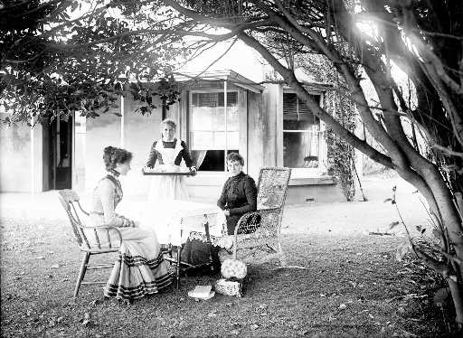 Domestic service was the single largest employment category for women until the Second World War. Servants worked long hours for little pay, and in New Zealand most were the sole domestic worker in the household. By the time this maid served afternoon tea at Mansion House on Kawau Island in 1901, she would have already performed nine hours' work.