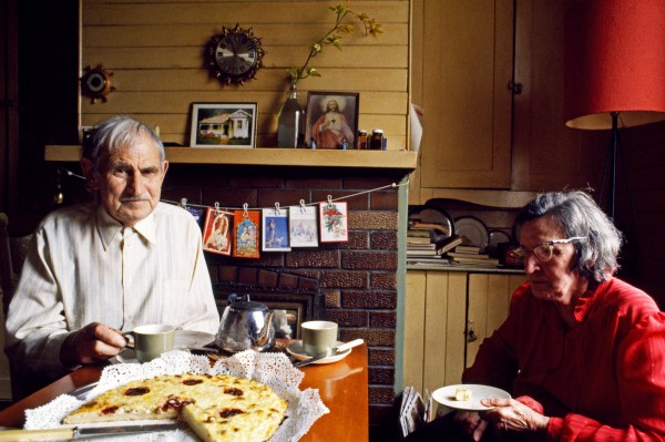 """Steve Straka and his wife Eva (nee ScholJum) enjoy a traditional Bohemian treat: kochen, made from cheese curd. """"Don't know if I had kochen before I was one, but I've had it everyone of my last 80 years,"""" confides Steve. Eva has Jived in this house since childhood; her parents built it around the time of the First World War."""