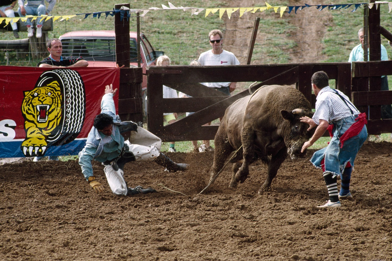 """A cowboy can get real sick, real quick out there,"" says bullfighter Paul Brown. His job-the most dangerous in the rodeo-is to rescue cowboys who have become entangled with the bull, cut them loose and divert the bull while the rider gets away. Bullfighters are dressed and made up like clowns to attract the attention of the bull, but their business is no laughing matter. Says Brown, ""You've got to show the bull who's boss."""