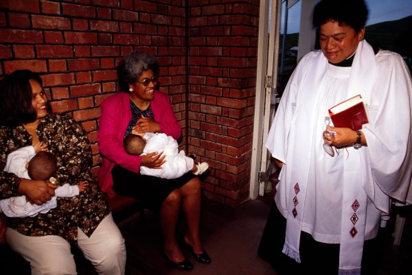 Honey Lee and Nohoroa Haapu's baby Kairoeroe share a meal break while their mothers chat to Rev. Lovey Pahau before Kairoeroe's christening.
