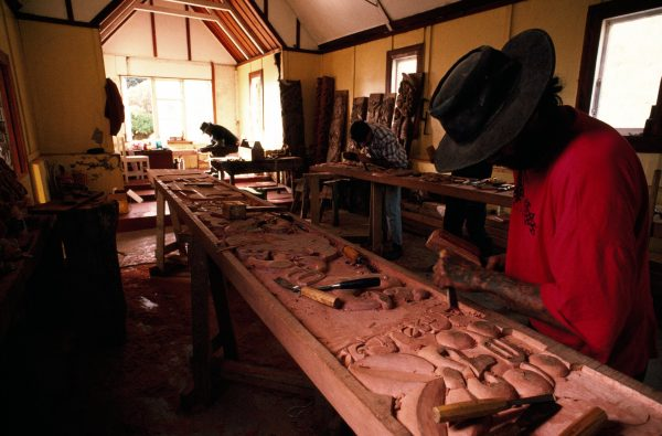 A forbidden place to women until the carving is completed, Raukokore's old Catholic church serves as a workshop for carvers Mando Waenga (foreground) and Tiger Waititi, applying skills they learned in jail. Under the direction of master carver Paddy Eruera, they are working full-time on restoration of Hine Mahuru, the meeting house of Raukokere's Wairuru Marae. A rarity in the mainly Anglican district, the church was built in 1934 to cater for a few local families and Irish roadmen who helped put the road through to Cape Runaway.