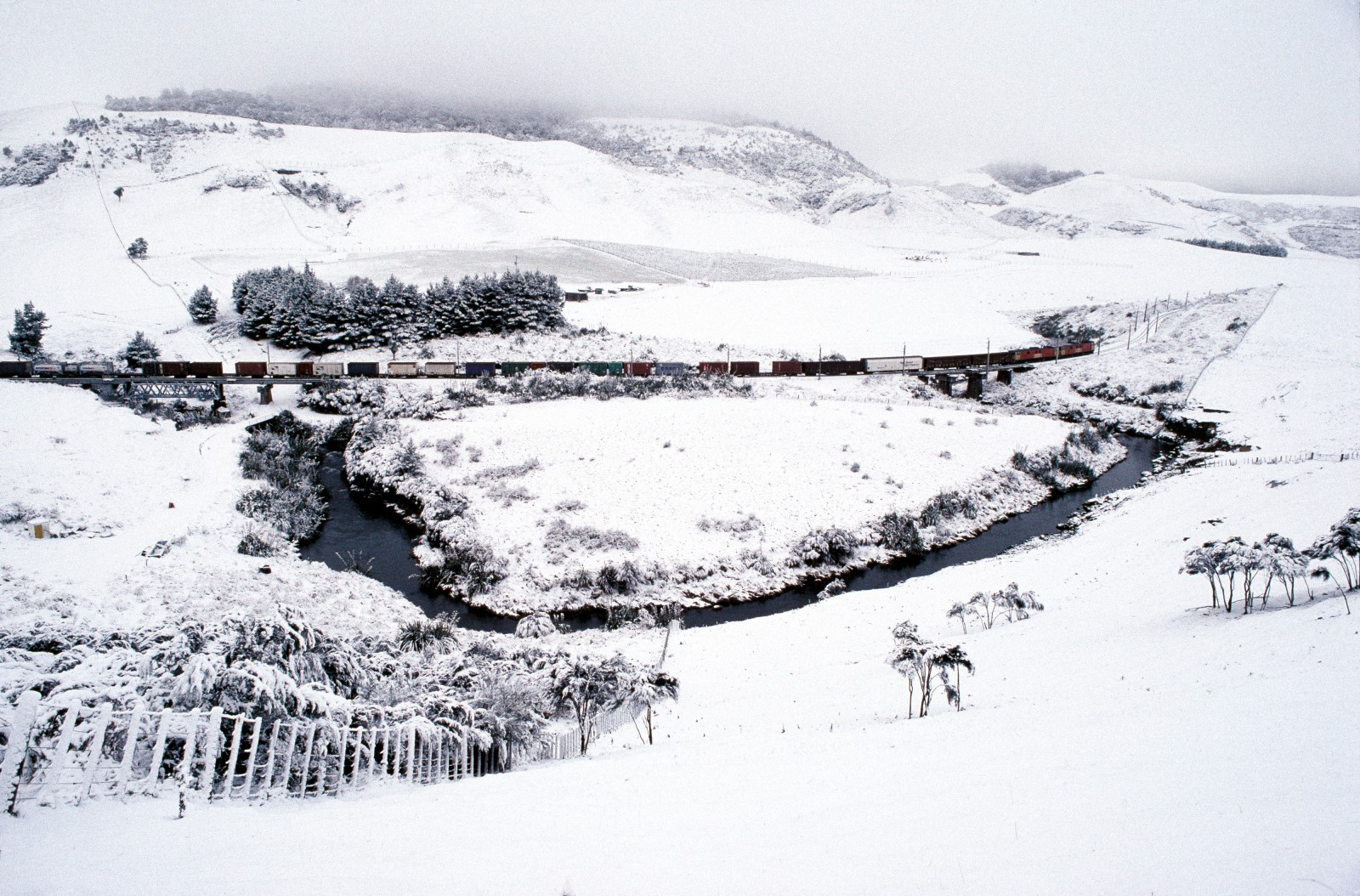 Untroubled by the mantle of snow that often closes the nearby Desert Road, a freight train rumbles through the central North Island winter south of Waiouru. Freight accounts for 70 per cent of rail revenues, and the North Island Main Trunk Line carries over a third of all freight transported by rail in the country.