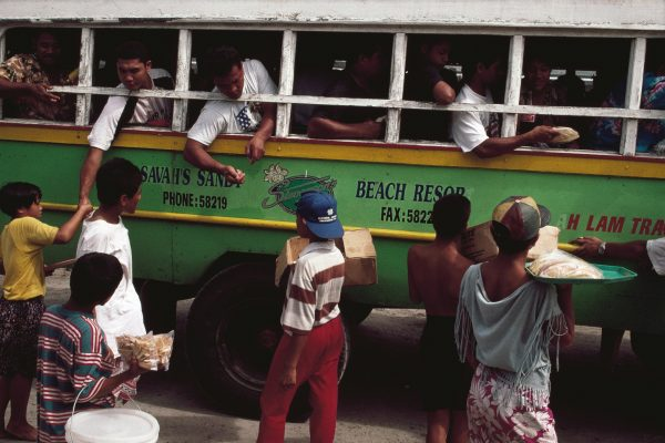 The spirit of free enterprise is alive an well in Samoa, as shown by these young entrepreneurs selling taro chips to bus passengers as they await departure.