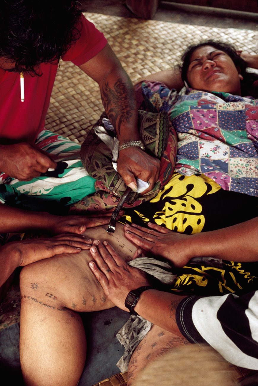 Repeatedly pierced with a tool shaped by pocket knife from boar's tusk, the recipient of a tattoo is supposed to show no pain. Tattoos on women's legs are delicate, often imparting the appearance of patterned stockings, whereas those adorning men tend to completely cover the skin. Samoa is one of the traditional homes of tattooing and the tufuga (tattooist) incising this pattern is internationally recognised.