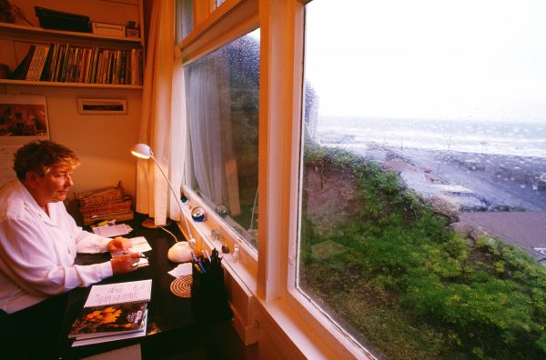 Writer Yvonne du Fresne finds inspiration from her muse in the restless vista of Cook Strait surging outside the study window of her home at Makara on Wellington's west coast.