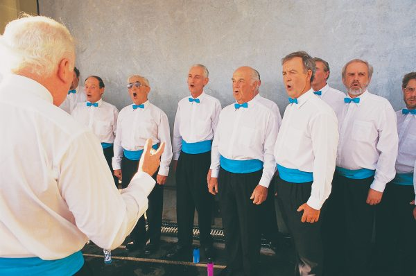 The Marlborough Sounds, a barbershop group, sing in a Variety Club function to raise funds for the Blenheim hospital to purchase a scanner. Although the drought has affected the region's economy, locals say it is the steady erosion of government funding for services such as health that poses the greater threat to rurally based communities.
