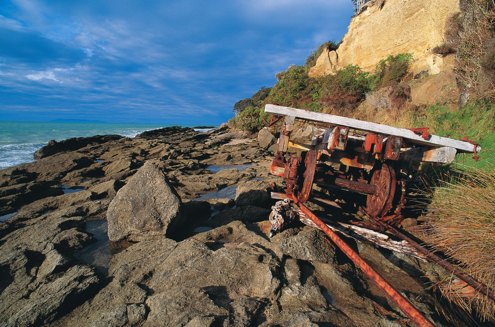 Rusty rails and derelict machinery near Port Craig recall a 1920s sawmilling venture in which timber was extracted by means of a tramway and carried by barge to Bluff. The Waitutu coast is rich and rugged, and regularly feels the the lash of southerly storms.