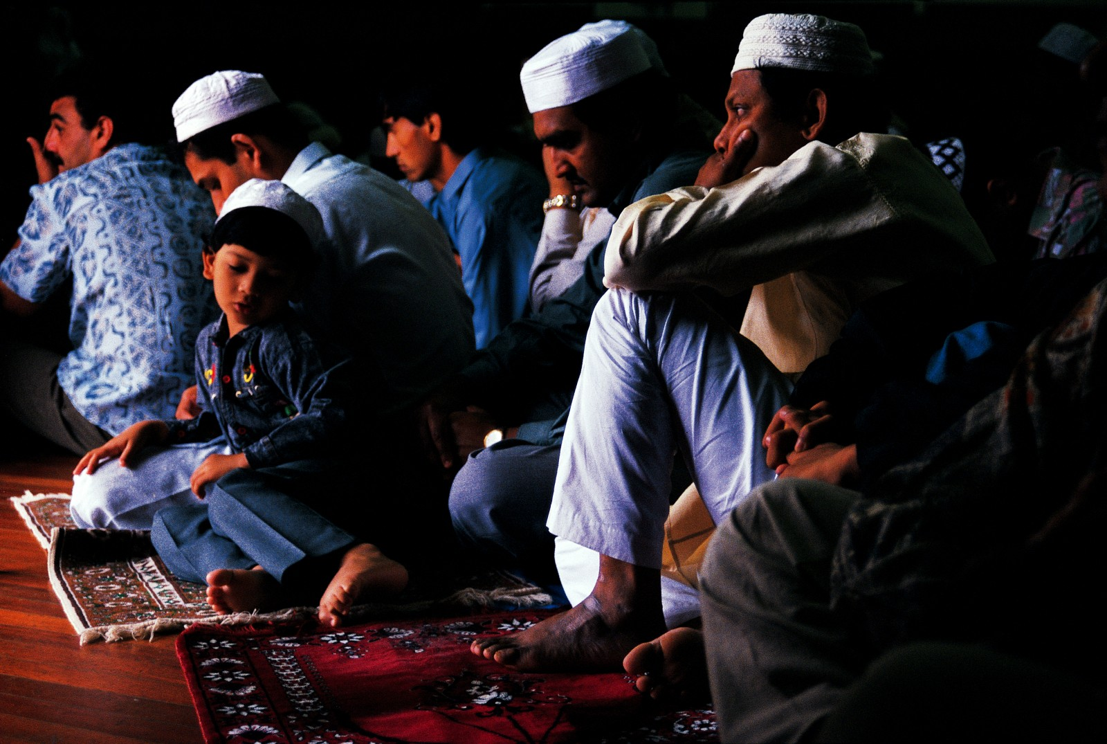 The majority of New Zealand's Muslims live in Auckland, though they have come from places as diverse as Fiji, Nigeria and Egypt. They find comfort in the brotherhood-its very idea deeply rooted in the Ouran. Meetings are often held in community halls hired for the occasion, as numbers frequently exceed the capacity of Auckland's three relatively small mosques. During the feast of Eid-ul-Fitr, observed on the day following the last day of Ramadan, members of the community listen to an address by the Imam.
