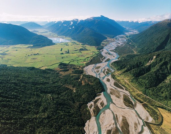Nestled beside the Taramakau River, Highway 73 from Arthurs pass turns south, along the face of the Alps and directly along the Alpine Fault. To the north, the fault crosses the Taramakau and passes between Lake Poerua and the Alexander Range, then heads via distant saddles towards Haupiri and Springs Junction.