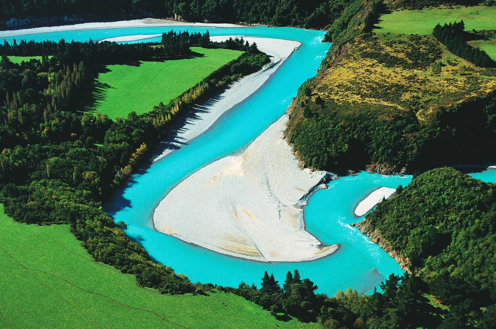 Rakaia River: Near Mt Hutt, the mighty Rakaia River--for most of its course a braided network of meanders snaking across a gravel bed several kilometres wide--is constrained into a single surging channel. Glacial melt, from the river's source in the heart of the Southern Alps, gives it a milky turquoise colour.