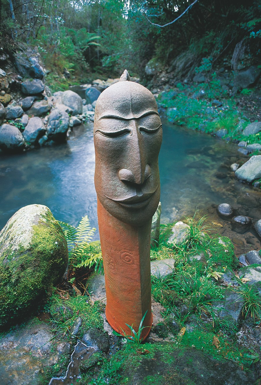 "Perhaps because they handle the very stuff of Earth, many potters have raised their voices on behalf of the planet's health. Michael O'Donnell's ""water guardian,"" which keeps watch over a forest creek at his pottery near Paeroa, was fashioned as a silent witness to environmental damage from goldmining in the region. The figure is one of a series in which the artist seeks to express human affinity with nature—a connection O'Donnell fears is becoming lost to the modern world, and one he seeks to reawaken."