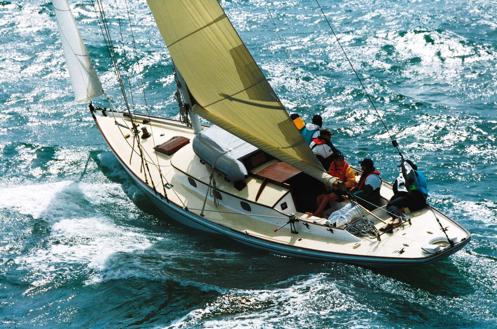 """Modern racing yachts fight the water. Little Jim and her kind work with it,"" says Hamish Ross. They may not be yachting's Formula 1, but for beauty of line and sheer durability the graceful ships of the Logan-Bailey era—Rolls-Royces of wind and wave—take undisputed line honours. Under full sail yet, they have many a league ahead."