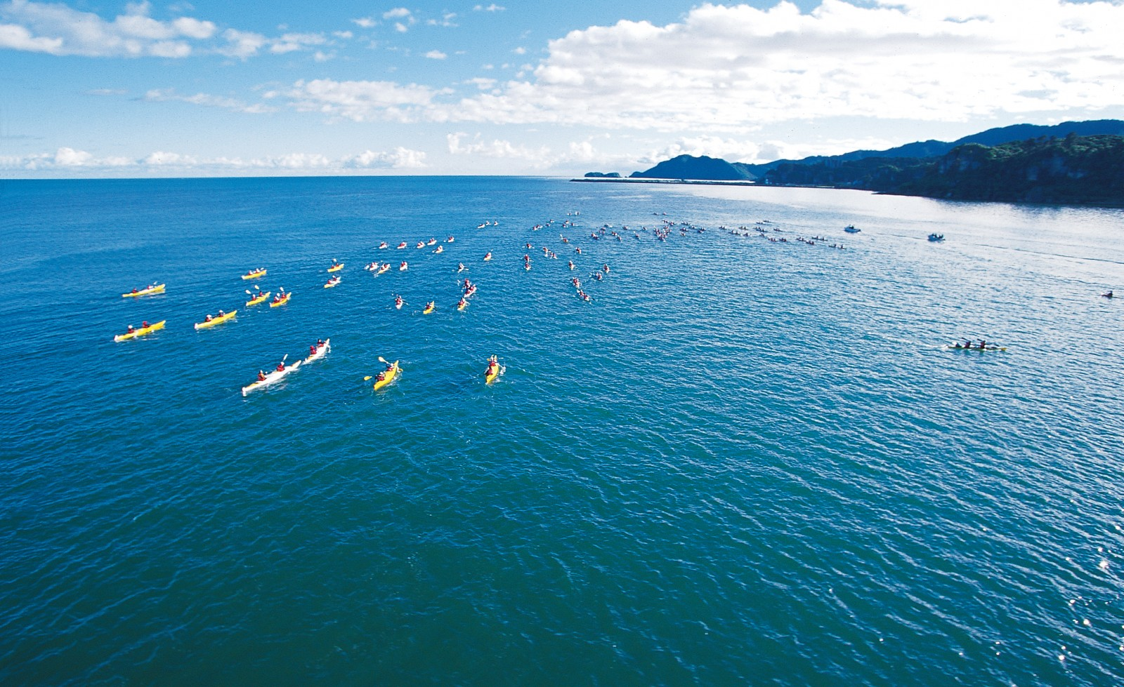 Paddles flailing, competitors speed towards Abel Tasman National Park during the first leg of the race. For most, this is the last time they will see the frontrunners for the rest of the week. Below: crossing a ford on the Whangapeka River.