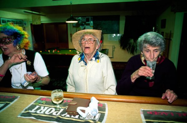 "Pubs, which outnumber stores three to one, are the focus of Blackball's social life. During ""Australian night,"" Norma Christie (centre) and sisters-in-law Emma Jane Naylor (left) and Emma Naylor—wearing garb that would do Barry Humphries proud—slake their thirst at the Working Men's Club."