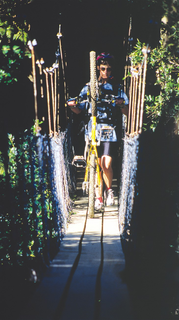 A swingbridge on the Queen Charlotte Track, in the Marlborough Sounds, calls for a dismount—one of the few spots on the popular 67 km trail where the ignominy of taking one's feet off the pedals must be accepted. Bikers and hikers share the trail, except during summer, when part of the trail is off limits to cycles.
