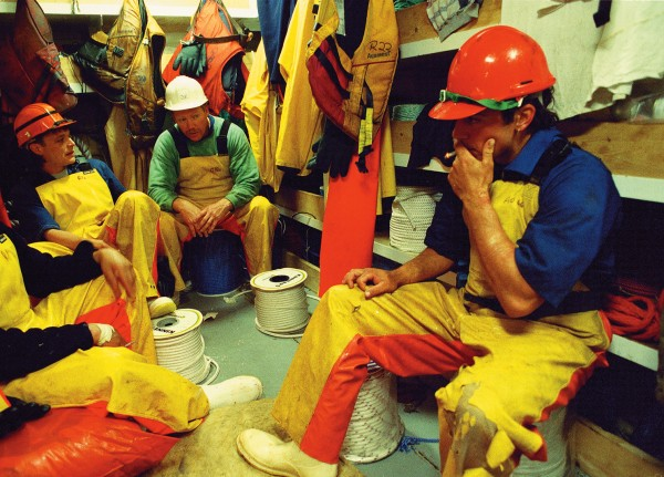 Once a full bag of fish-as much as 60 tonnes' worth-hits the deck, there is not a lot of time for sitting around, and work will continue at an intense level until no more fish remain to be processed. Here deckhands snatch a breather during a long night of toil