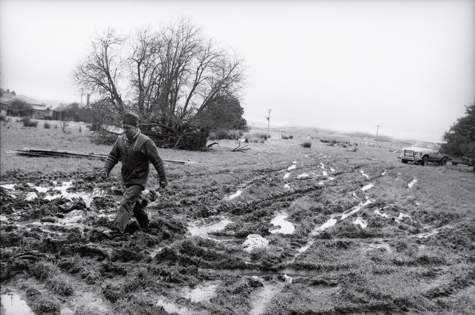Dave MacGibbon crosses the winter slush of a tyre-marked paddock on a mission to borrow timber for a new fence from his neighbour, Bruce McNaughton.