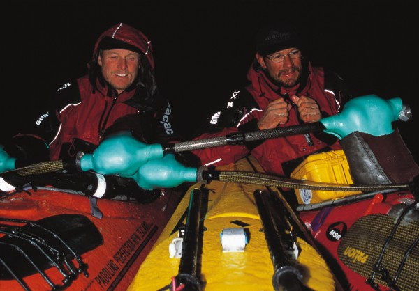 """Landing places on the Antarctic Peninsula are few and far between, and some of the planned stopovers proved impossible-meaning that pleasant daytime meanders (above) sometimes turned into late-night marathons (below). As temperatures fell, drips from the paddles slicked the kayak decks with ice, and fingers and faces were numbed to the bone. At such times, the paddlers were thankful for their foam""""pogies""""-hand insulators fixed to the paddles."""