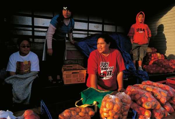 Captured on a wintry Saturday afternoon in 2002, these Wiri fruit vendors were ever hopeful of a car pulling over for a bag of persimmons or mandarins. Nerissa Semisi (left), Ollie Taulua, Alice Autufuga and Nephi Leatigaga have since lost their lay-by possie to a road-widening scheme.