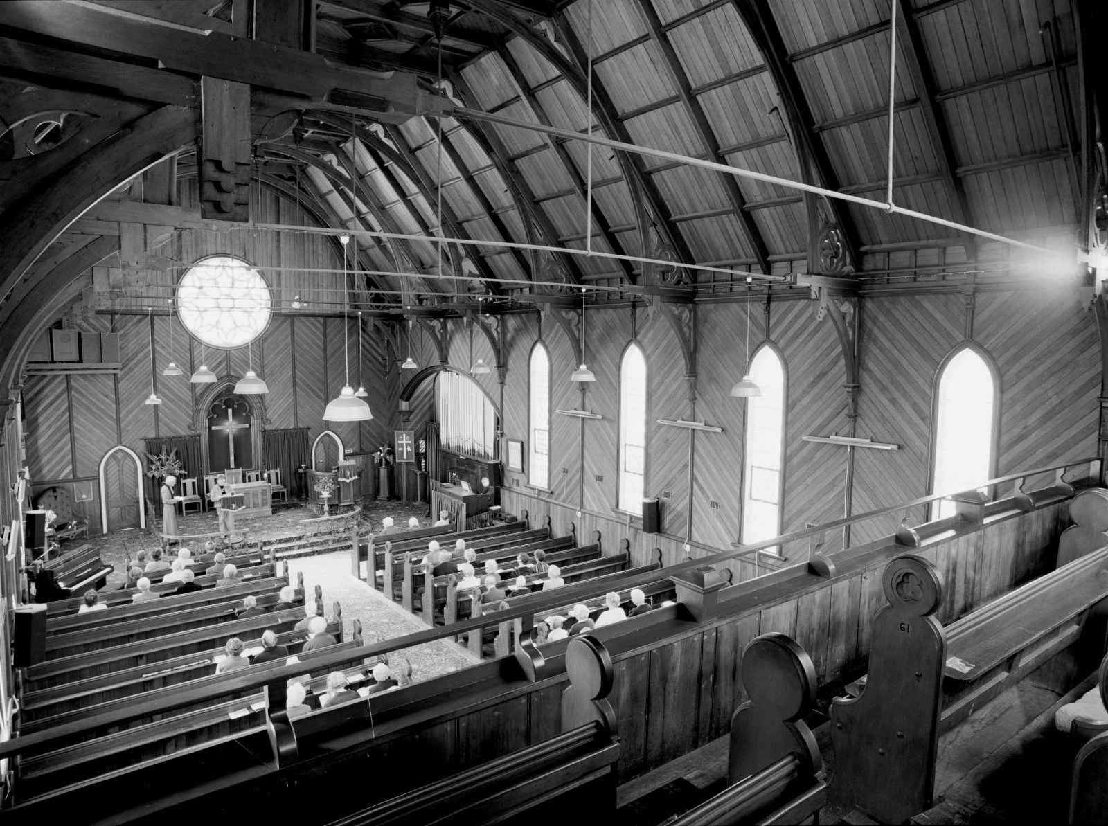 A combined Methodist-Presbyterian congregation celebrate together within the kauri walls of Saint James Union Church.