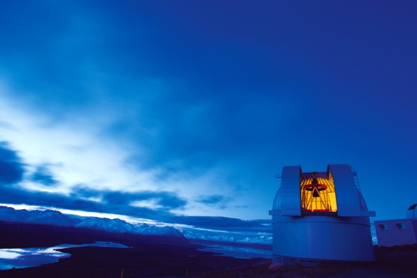 The MOA telescope at Mt John Observatory awaits as a clearing front reveals the night sky.