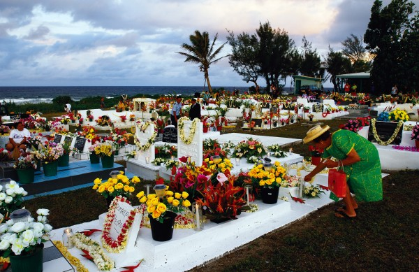 At the Panama Cemetery on the outskirts of Avarua, gravestones are lavishly decorated for the festival of Turama, All Souls Day, a Catholic celebration commemorating the dearly departed. Cook Islanders have long honoured their ancestors, and loved ones are often buried on family land next to their homes. On the island of Mitiaro, graves are decorated with plates and cutlery and food is laid out by family until the spirits are thought to have gone to their final rest.