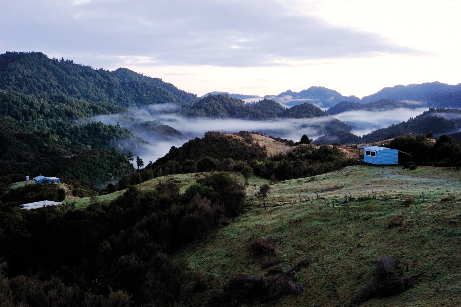 """'Children of the mist', a term coined by ethnologist Elsdon Best in the 1920s, has been applied to Tuhoe ever since. But it is more than a romanticised label. In Tuhoe's world view, it describes the literal origins of the people—from the land itself. """"If you know where the mist comes from, then that is where I come from,"""" kaumatua Rehita Taputu told the Waitangi Tribunal. At Maungapohatu, the mist remains but most of the children have gone. Only a handful of residents now live here, where once a community of 1000 thrived in Rua Kenana's 'New Jerusalem'. But change is apparent: summer baches are springing up among the crumbling relics of the past."""