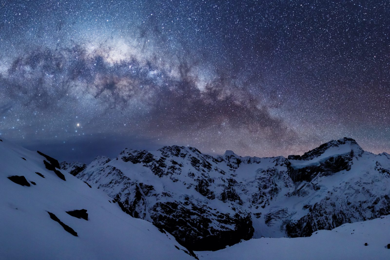 The Sierra Range, a rampart of the Southern Alps, bathes in starlight. This massive wall of rock is largely responsible for the extraordinarily clear skies over Canterbury. The westerly wind cools as it rises over the snowy turrets, condensing the moisture that falls as snow or rain, predominantly west of the range, leaving the leeward side dry, clear and low in humidity—vital ingredients for stargazing.
