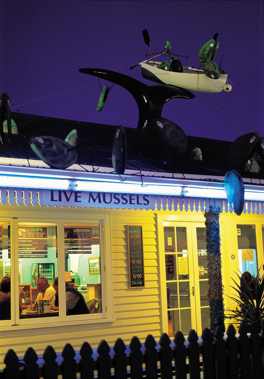 There's no getting away from fishy themes in Kaikoura. At Mussel Boys restaurant, patrons dine beneath a tableau of frolicking whales and molluscs, while at Solice, one of the town's newer bars, a piscine sculpture overshadows Dominic Bösel as he lines up a shot.