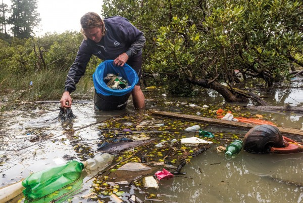 One bit of flotsam at a time, Hayden Smith picks litter from Henderson Creek in Auckland. Since 2002, he and colleagues at the Watercare Harbour Clean-Up Trust have rid 3,672,338 litres of rubbish from the Waitemata and Manukau Harbours, and from the Gulf Islands—nearly 30 million individual pieces of litter. Enough rubbish ends up in Auckland waterways to keep the trust's purpose-built vessel and two contractors employed full-time.