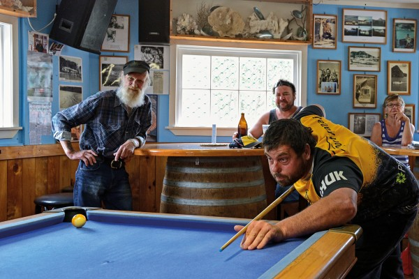 Dairy farmer Rodney Burkitt takes his best shot at the Gum Store pool club tournament, held every Sunday at Totara North's historic bar/cafe.