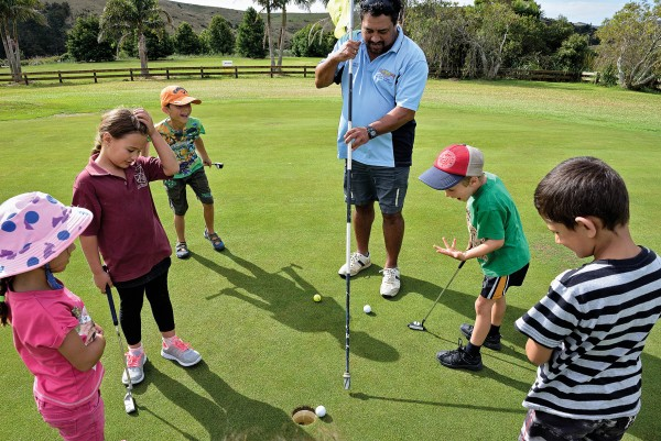 When not involved with rugby, Kingi coaches at the local golf club, where a group of youngsters work on body language appropriate for a putt that couldn't possibly miss—but did.