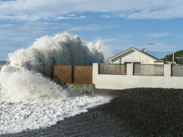 """We have gone inside the lion cage,"" says coastal engineer Jim Dahm about our propensity for building next to the sea. On the Cape Kidnappers coast, the shoreline retreated by tens of metres following the Napier earthquake in 1931, and chronic erosion has continued. When king tides combine with high swells, the seaside baches of Haumoana take a hammering. But residents have no intention of giving in. ""Nothing a bit of drying won't fix,"" said the owner of this home after storm waves broke a glass door and flooded the interior in 2011."