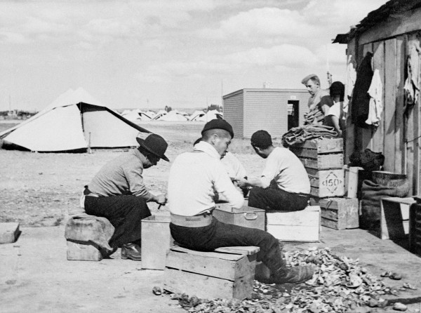 Prisoners of war peel potatoes for the camp kitchen. Such forced labour was not eagerly attended to by the Japanese, who found it demeaning. According to the terms of their military code, an honourable death would have been preferable. Many would get their wish within months.