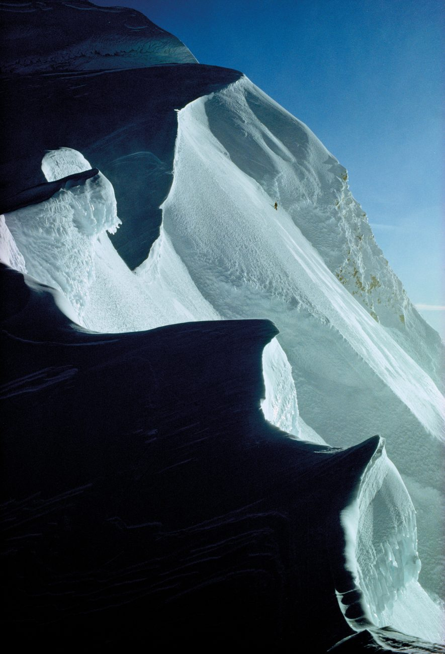A solo climber nears the top of the Caroline Face, approaching the summit ridge of Aoraki/Mt Cook. Four climbers lost their lives in the 1960s while attempting to scale the 2000-metre wall of ice.