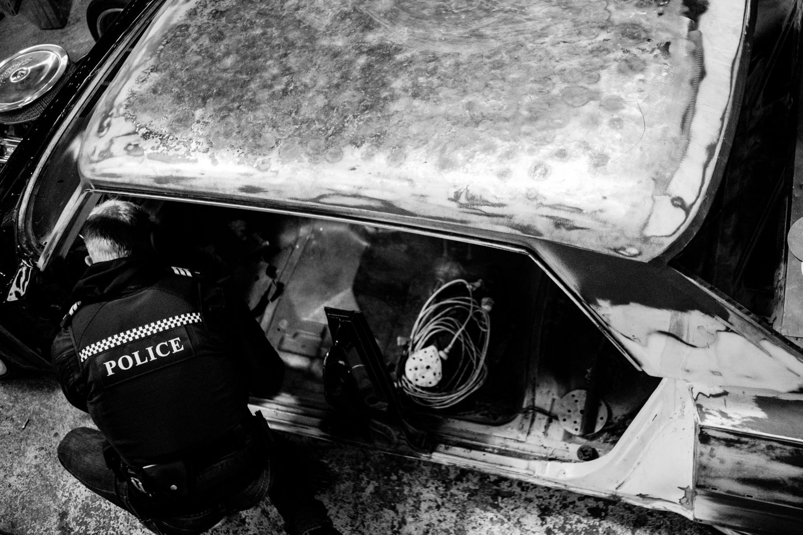 Leaving no stone unturned, an officer searches a business address in Wellington for drugs and articles that might identify criminal associates. There is a penalty of six months in prison for possession of methamphetamine and/or a $1000 fine. Possession of five grams of methamphetamine (a teaspoon) is enough to warrant a conviction for supply, which carries a penalty of life imprisonment.