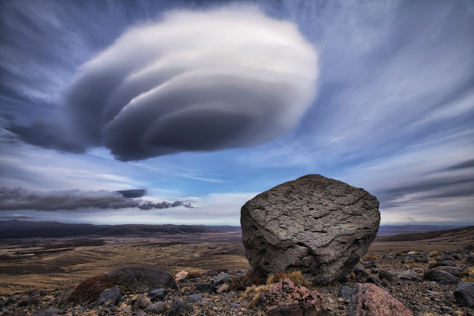 A rare lenticular cloud hangs above the eastern slopes of Mt Ruapehu in the Rangipo Desert during a northwesterly weather pattern. The distinctive lens-shaped formations are almost stationary and are normally aligned perpendicularly to the wind direction. Bevan Percival was captivated by the unusual shape of the cloud and the way in which it appeared to hover over the large boulder—a volcanic projectile—in the foreground. He spent several hours with his son watching the cloud develop and searching for the right angle and an interesting foreground.
