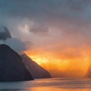 Sunset and low cloud combine to give Milford Sound an apocalyptic glow. Mitre Peak, named for its resemblance to the shape of a bishop's headwear, is silhouetted at left. West Coast-based photographer Petr Hlavacek—originally from the Czech Republic—has photographed the fjord many times over the years, from different vantage points and with different qualities of light. On this occasion he waited seven days for the right conditions.