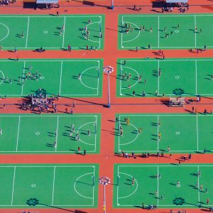 Children play at the AMI Auckland Netball Centre. Richard Robinson was photographing road construction for the New Zealand Herald from a helicopter when the grid and vivid colour of the netball courts caught his eye. Robinson says that whenever he has the chance to shoot stories from above, he looks for interesting patterns to photograph, such as the long shadows cast by players and nets on a winter afternoon.