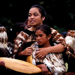 Shivering girls from an all-female waka crew huddle together for warmth during Waitangi Day celebrations on February 6, 2014. On assignment for the New Zealand Herald, Dean Purcell was looking for an image that captured the day's gloomy, blustery weather. He found it as crew members from various iwi gathered for a pōwhiri on shore before the launching of the waka, one of the main events of the day.