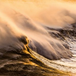It was a gusty September day when Jason Hosking went exploring the coastline of the lower Wairarapa, south of Castlepoint. High seas and strong offshore winds combined to create big plumes of spray off the back of the waves, while the very last light of the day lent a golden touch to the scene.