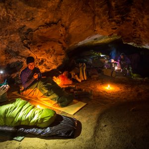 Bulmer Cavern is New Zealand's longest cave system, with more than 70 kilometres of underground passages explored so far. In late 2014, five cavers spent a week camped underground in temperatures of three degrees—the same as a refrigerator—to investigate the sources of its streams. They placed fluorescent dye in a north-flowing stream at one end of the system, which emerged several days later at Blue Creek, almost nine kilometres to the north and across a drainage divide, suggesting the Bulmer system is much more extensive than originally believed. Afterwards, the cavers emerged to bad weather and a mountainside coated with 40 centimetres of snow, forcing them to retreat and wait for conditions to improve.
