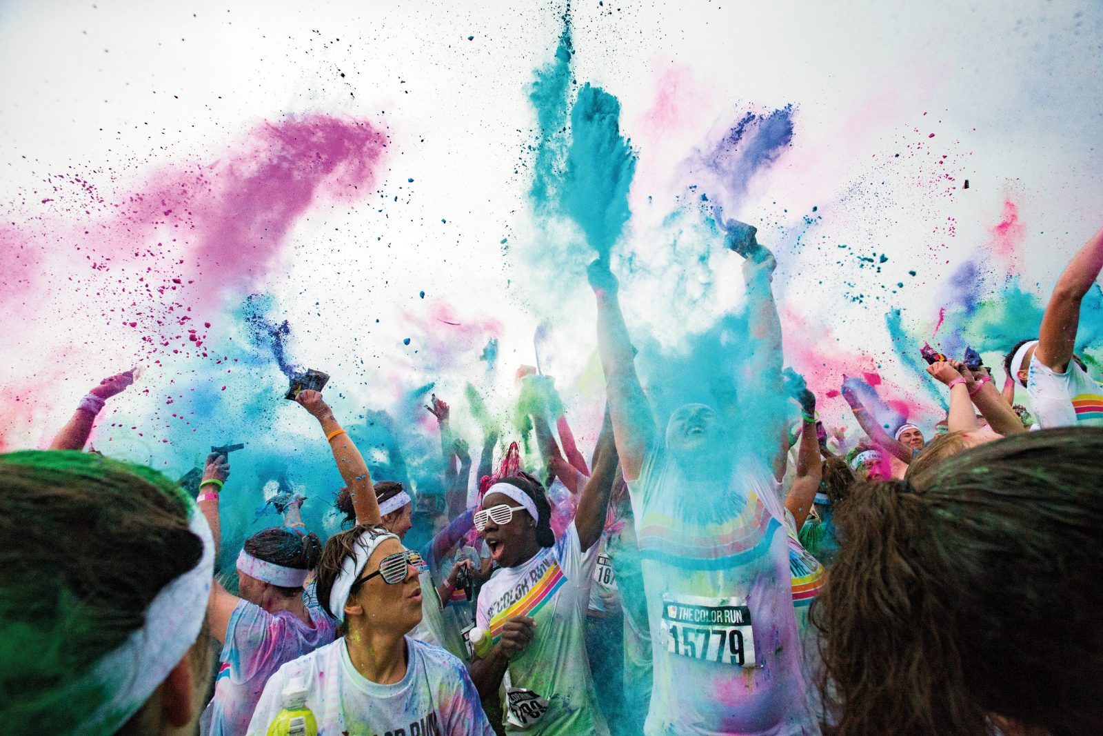 "During the five-kilometre Colour Run, inspired by the Hindu festival Holi, participants are encouraged to wear white clothing, and coloured powders are thrown at them as they loop the course at Canterbury Agriculture Park. But the day dawned grey and wet, and the colours blurred and ran together during the race. It wasn't until the finish line dance party, when the mood lightened, that photojournalist Iain McGregor grabbed a plastic sleeve, wrapped it tightly around his camera, and joined in the fray. ""I went back to the office with multi-coloured hair, multi-coloured clothes,"" he says. ""Colour got everywhere."""